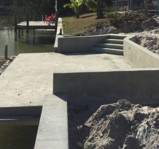 Completed patio dock at edge of seawall.