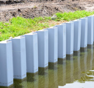 Vinyl panels are secured to existing seawall.